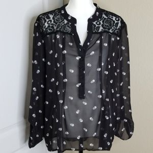 sheer black blouse with skulls and lace